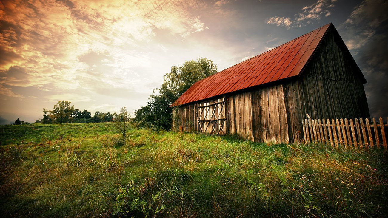 An old country barn at sunset.